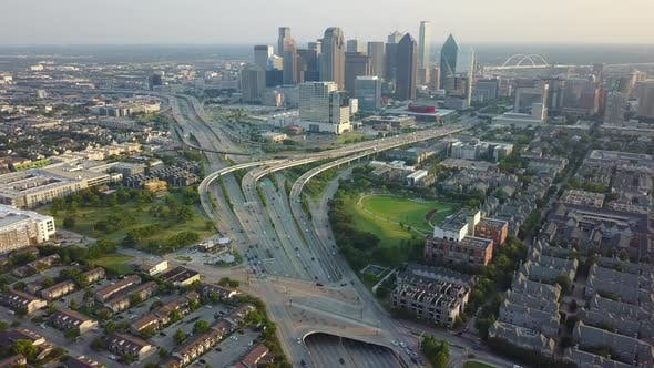 Thumbnail for Aerial Dallas Flying Over Freeway Traffic, Camera Moves Down, Sunset Evening
