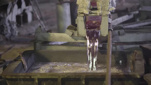 Thumbnail for Close-up, the Hot Metal Is Drained From the Furnace. Creek Molten Aluminum. Metallurgical Industry