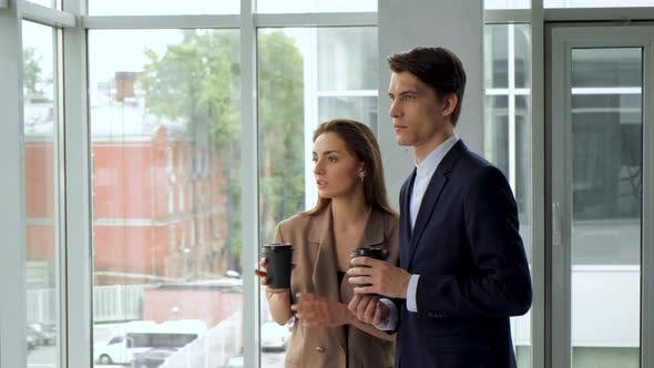 Thumbnail for Business team interacting while having coffee break in office. Successful happy professional