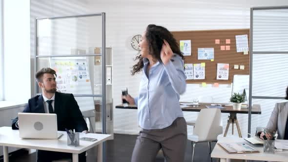 Thumbnail for Happy Businesswoman Learning Good News and Dancing in Office