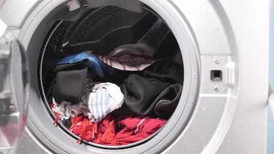Close Up of Cloths in a Washing Machine