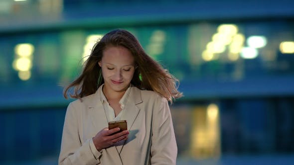 Thumbnail for Young girl at night reads message on the smartphone