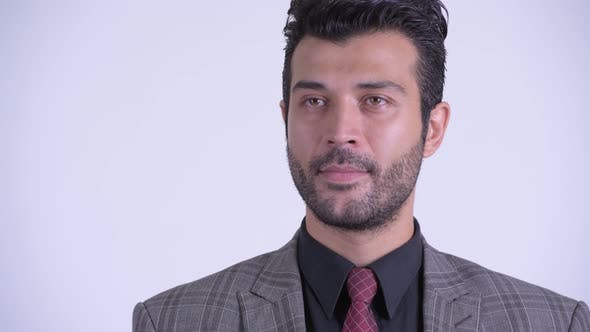 Face of Handsome Bearded Persian Businessman Thinking