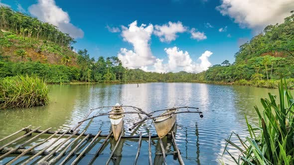 Cover Image for Old Wooden Fishing Boats in a Calm Lake Water in a Still Lake Water at the Siargao, Philippines
