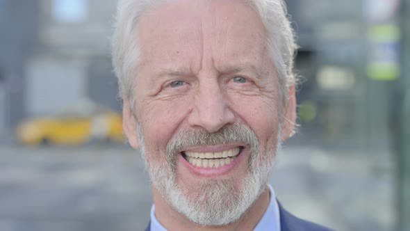 Close Up of Smiling Old Businessman