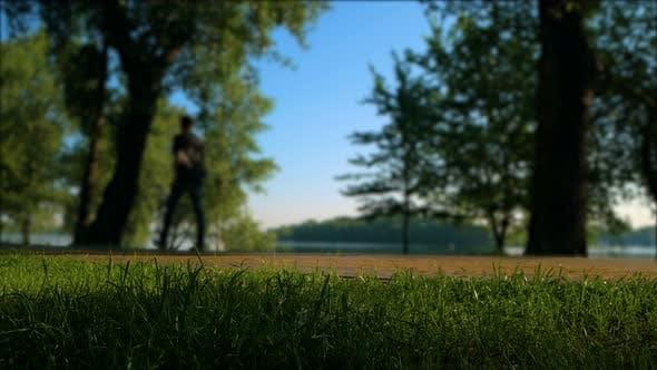 Sport People at Morning Park. Biking, Walking and Running.