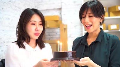 Asian Businesswomen Celebrating Birthday in Office