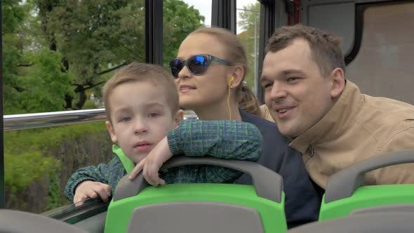 Thumbnail for Family of Three Riding in Doubledeck Bus