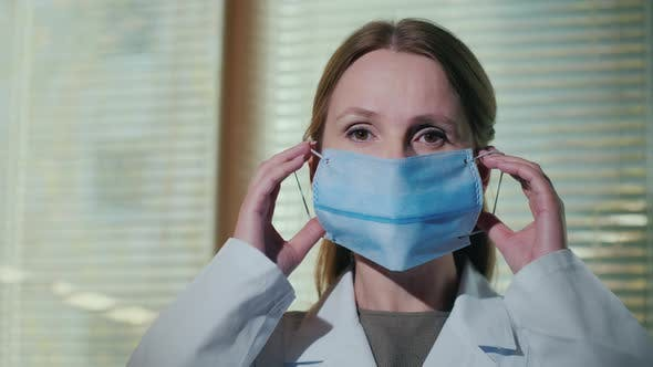 Thumbnail for Female Doctor Shows How To Wear a Medical Mask