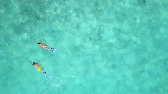 Romantic people on honeymoon vacation have fun on beach on paradise white sand background 4K