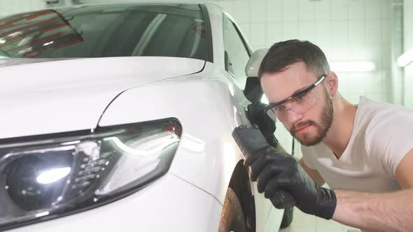Thumbnail for Man Checks Result of Polishing of Car with a Flashlight.