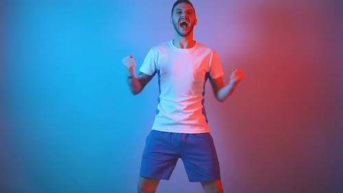 Enthusiastic Soccer Fan Celebrating Goal Raising Arms Fan, Support Concept Studio Shot