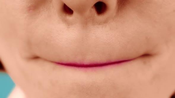 Lady Model Aligns Lipstick