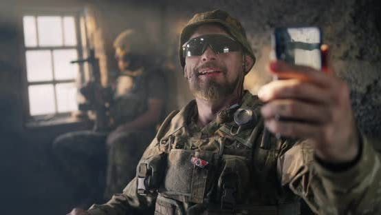 Soldier Taking Selfie with Squad Mate