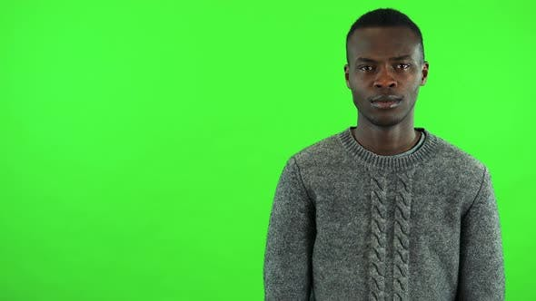 Thumbnail for A Young Black Man Is Angry and Shakes His Head at the Camera - Green Screen Studio