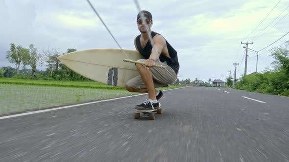 Thumbnail for Surfboarder Skitching on Skateboard in Bali