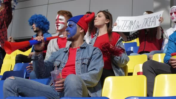 Thumbnail for Sports Fans Watching Match at Stadium and Supporting their Team
