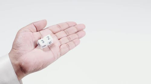 Hand Holds Numbered Dice   Three And Two Thirty Two
