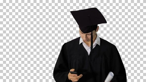Graduate student walking hand texting, Alpha Channel