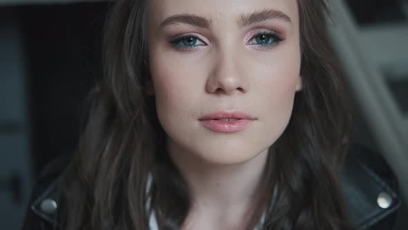 Thumbnail for Closeup Portrait of an Attractive Girl with Bright Blue Eyes.