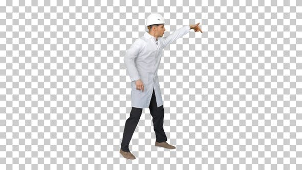 Young workman with helmet in white robe, Alpha Channel