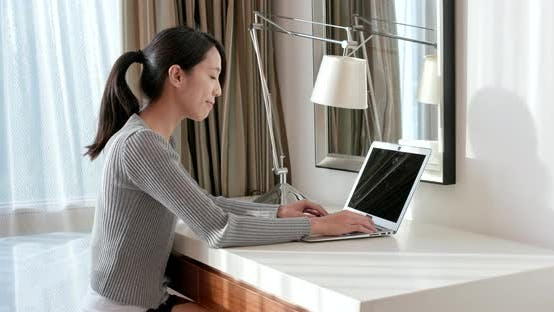 Cover Image for Woman working on laptop computer at home