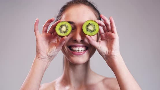 Thumbnail for Girl Hiding Her Eyes with Kiwi Slices