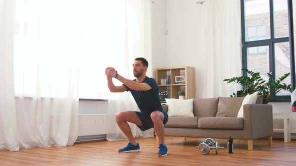 Thumbnail for Man Exercising and Doing Squats at Home 60
