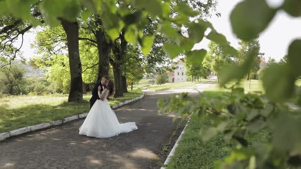 Thumbnail for Caucasian Groom with Bride in the Park. Wedding Couple. Happy Family. Newlyweds