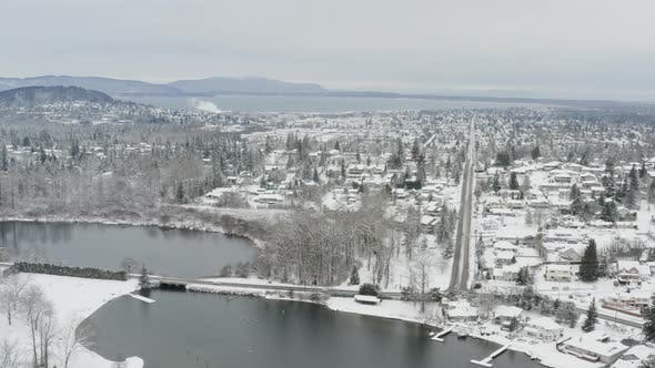 Thumbnail for Bellingham Washington Snowy Winter Day Drone Aerial Snow Covered City Landscape Overview