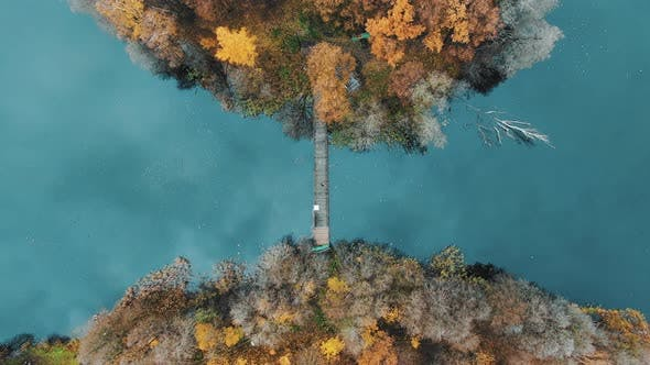 Fantastic Autumn Island on the Lake with a Bridge, Aerial View