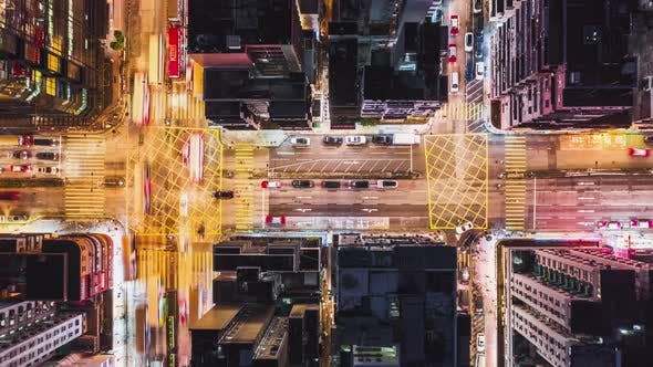 Thumbnail for Top view time-lapse of car traffic and people crossing street at night in Hong Kong city downtown