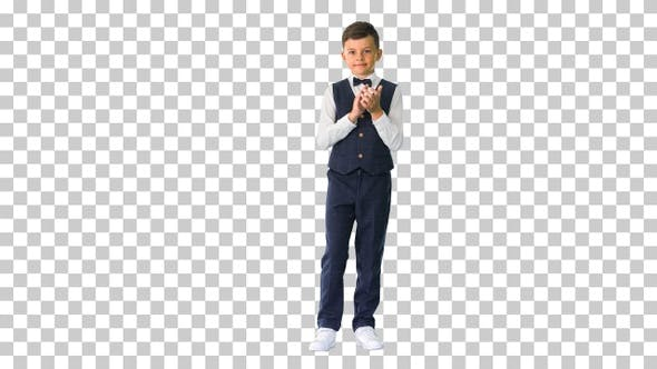Smiling boy in formal wear clapping, Alpha Channel