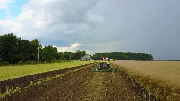 Thumbnail for Tractor Preparing Land