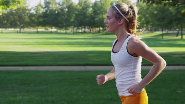 Thumbnail for Young woman jogging in park