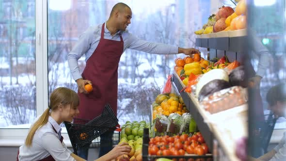 Positive Grocery Store Owners Working at Store