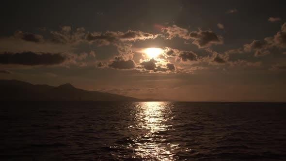 Sun Shimmering Ocean Clouds