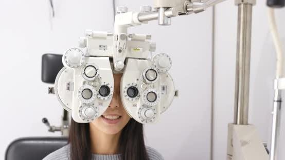 Thumbnail for Woman undergo eye exam