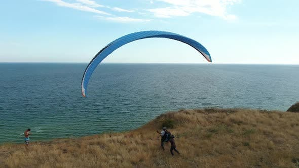 Thumbnail for Paraglider Is Landing on the Beach, Aerial View on the Sea
