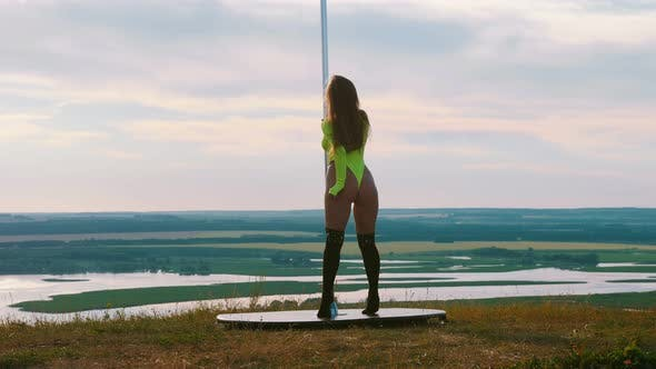 Thumbnail for Pole Dance on Nature - Sexy Attractive Woman in Neon Green Swimsuit Dancing By the Pole