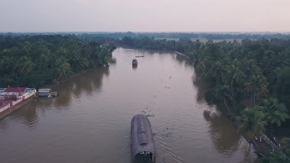 Houseboat tour on Kerala backwaters at Alleppey, India. Aerial drone view