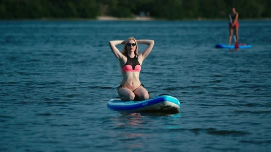 Attractive Blond Woman on Stand Up Paddle Board SUP Tropical Blue Ocean