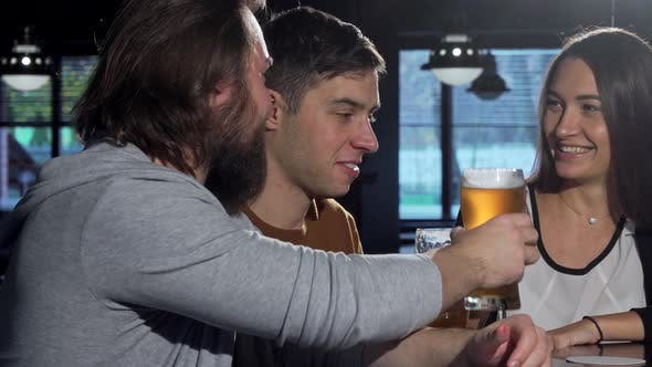 Thumbnail for Bearded Man Enjoying Delicious Beer with His Friends at the Bar