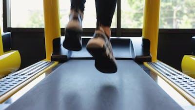 Legs Running on Treadmill in a Gym