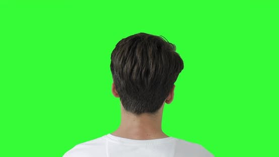 Thumbnail for Head Shot of Man On Green Screen. Male model Watching Tv. Shot behind model shoulders.
