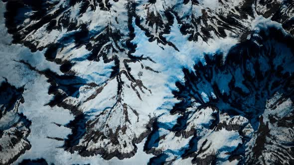 Aerial View of Snow Mountain Range Landscape