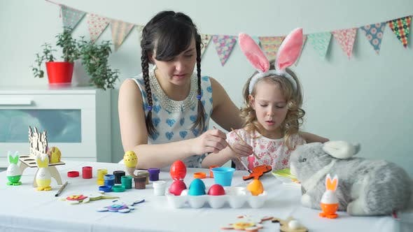 Little Girl and Woman Coloring Easter Bunny