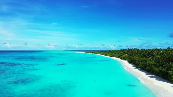 Luxury birds eye abstract view of a paradise sunny white sand beach and blue water background in col