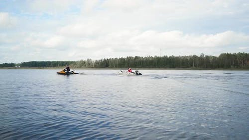 Jet Ski with Boat on Rope Tow
