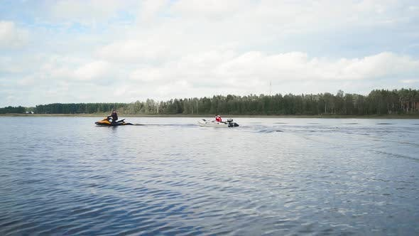 Thumbnail for Jet Ski with Boat on Rope Tow